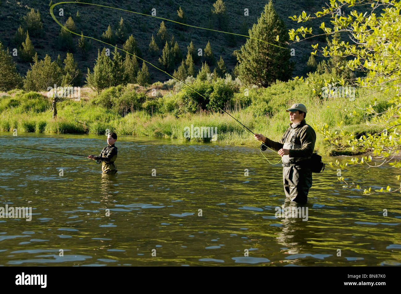 Father son fly fishing deschutes river oregon stock for Oregon free fishing
