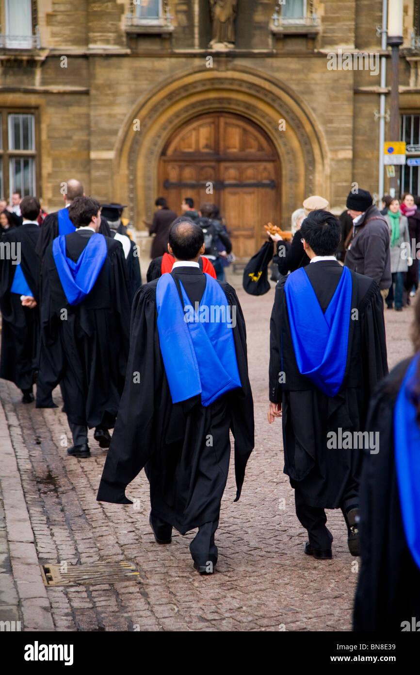 Graduates in graduation gowns / robes at a graduate /graduating ...