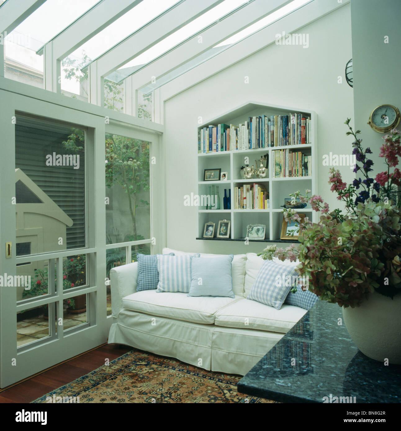 Living Room Alcove Alcove Shelving Above White Sofa In Modern White Living Room Stock