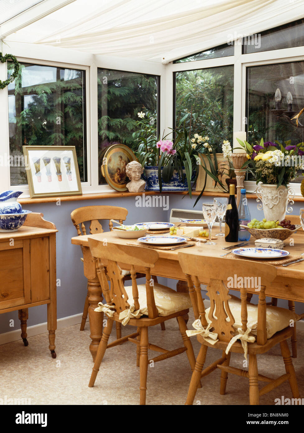 Wooden chairs and table in small conservatory dining room Stock ...
