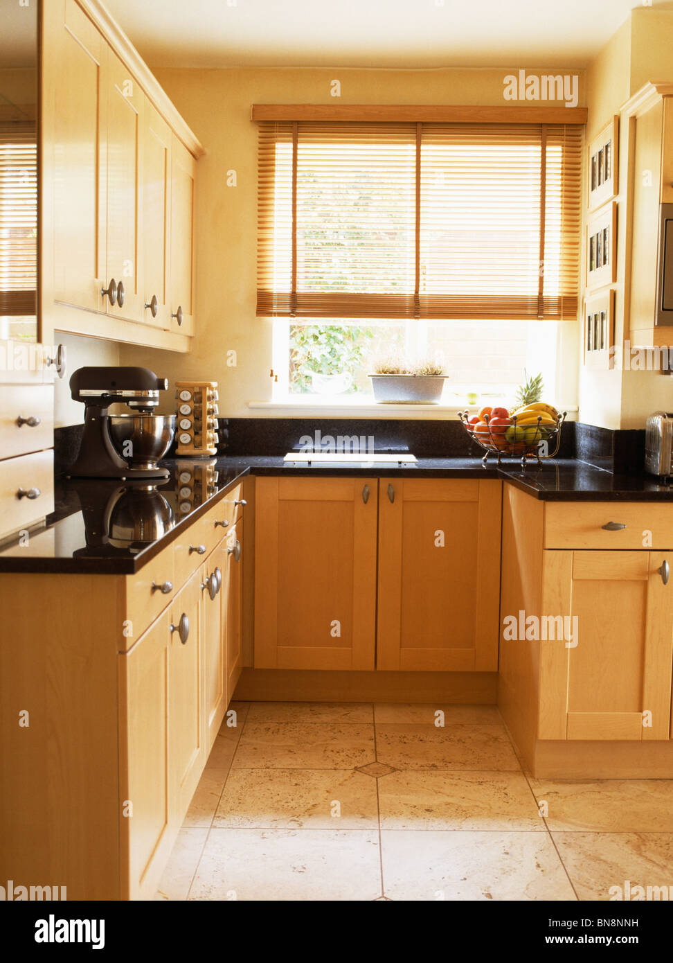 Small Fitted Kitchen Pale Wood Fitted Units In Small Modern Kitchen With Split Cane