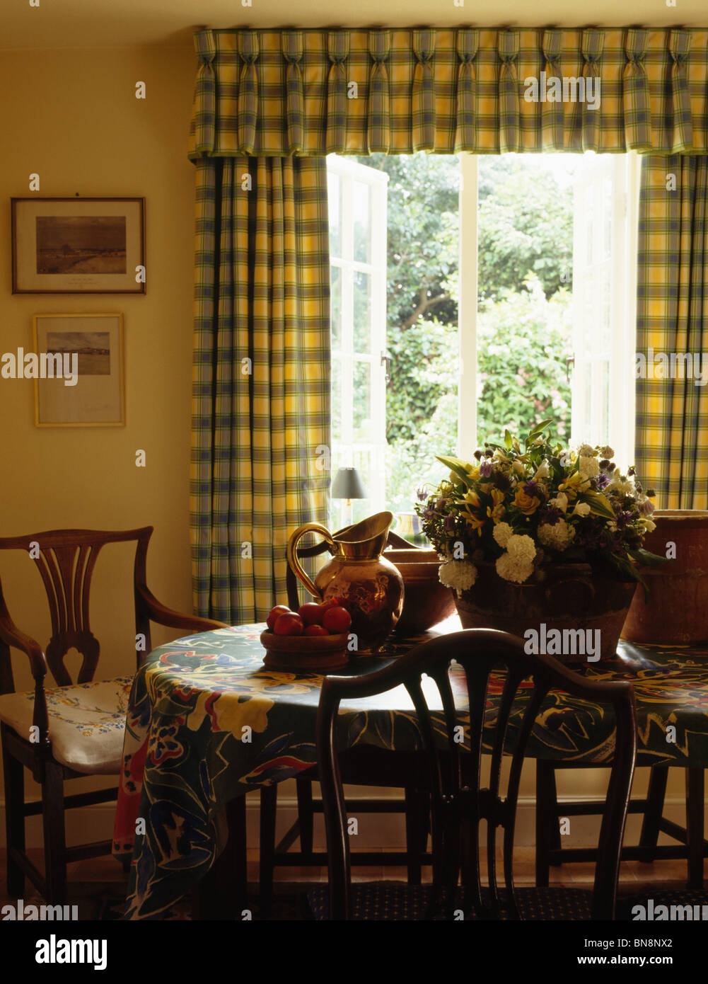 Yellow Checked Curtains On French Windows In Dining Room With Flowers In  Vase On Table With Floral PVC Cloth