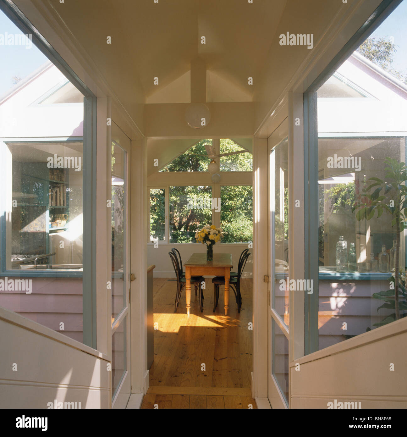 Doorway To Modern Kitchen Dining Room Extension With Wooden Flooring