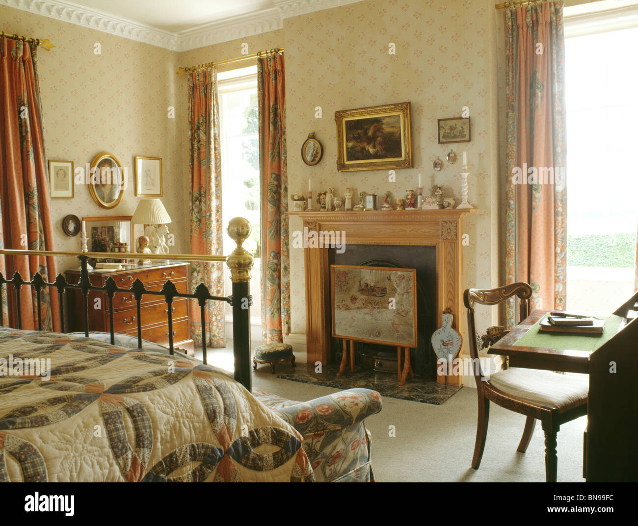 Antique furniture bedroom - Stock Photo Traditional Country Bedroom With Antique Furniture And Neutral Wallpaper And Pine Fireplace With Fire Screen