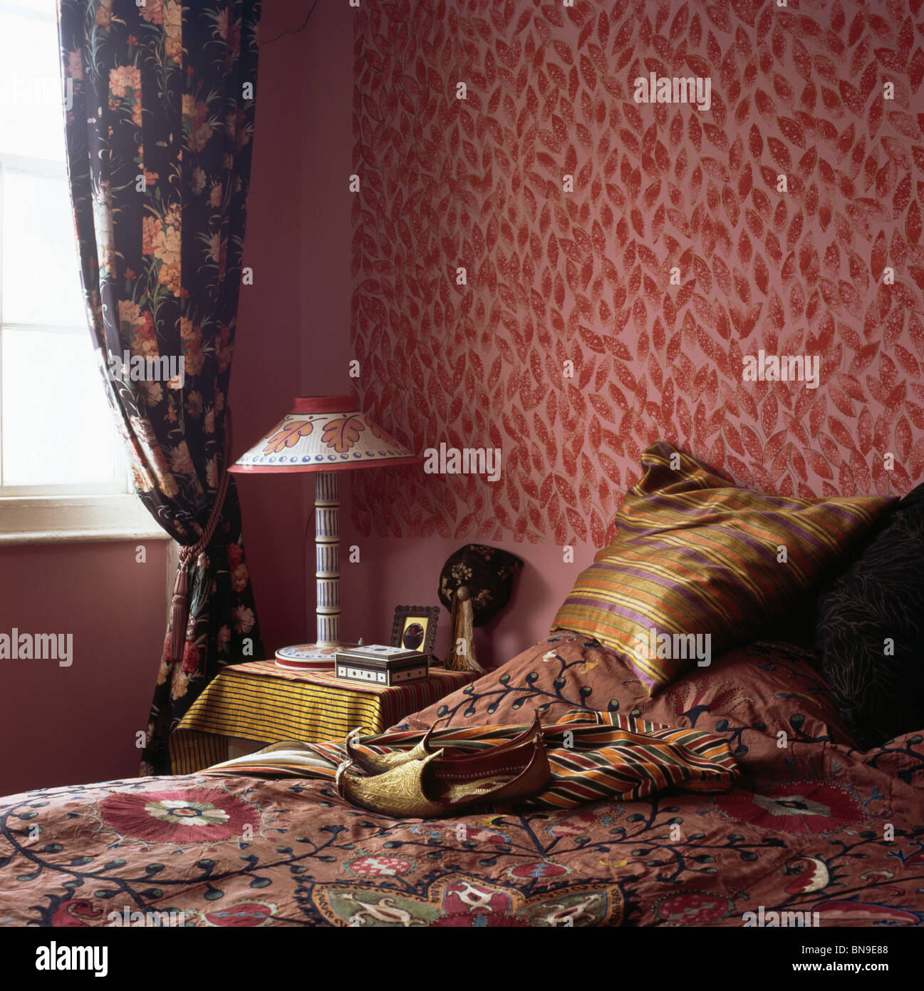 Patterned Red Wallpaper In Small Bedroom With Dark Blue
