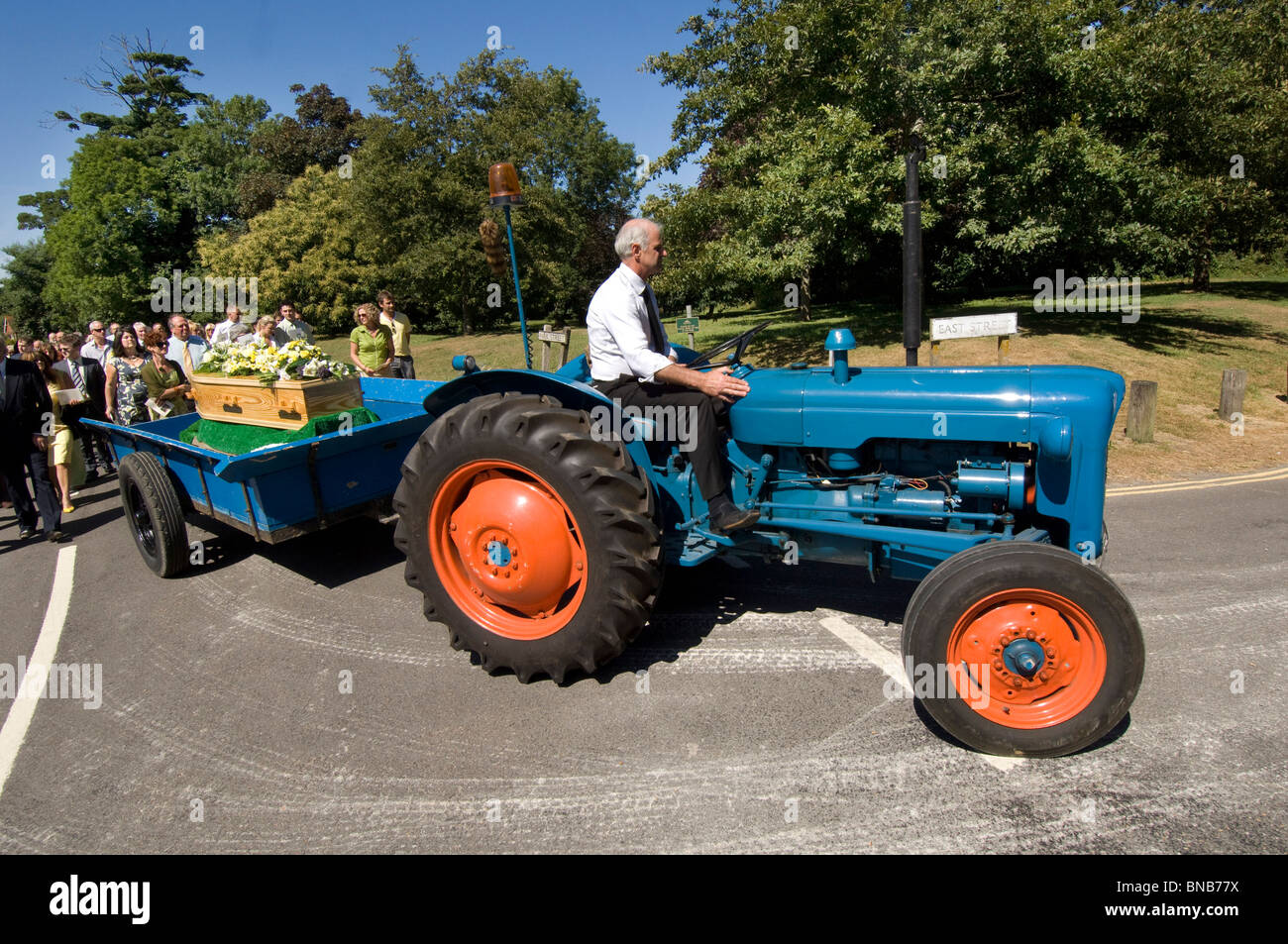 Ford Dexta Tractor : A vintage fordson dexta tractor pulls the coffin in