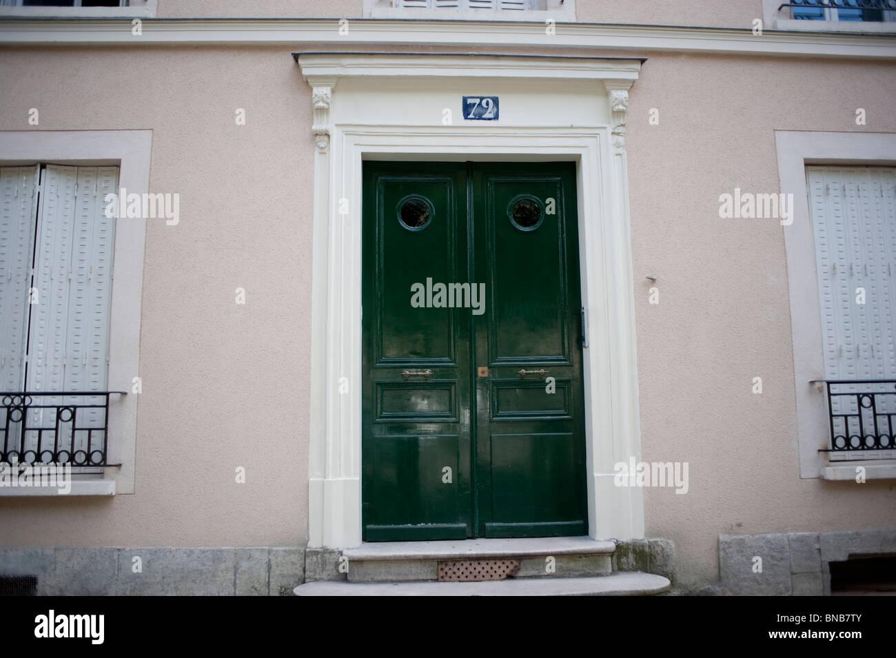 Apartment Building Front Door facade apartment building, paris, france, detail, front door stock