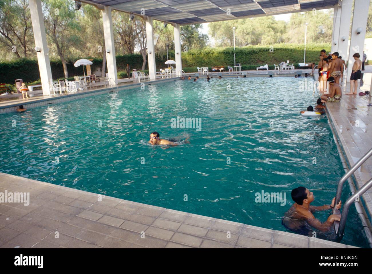 Dubai uae mushrif park teenager swimming in swimming pool - Dubai airport swimming pool price ...