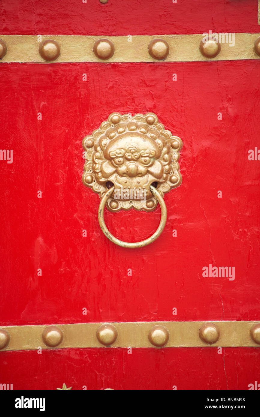 Ornate Door Knocker On Red Door Of Chinese Restaurant   Stock Image
