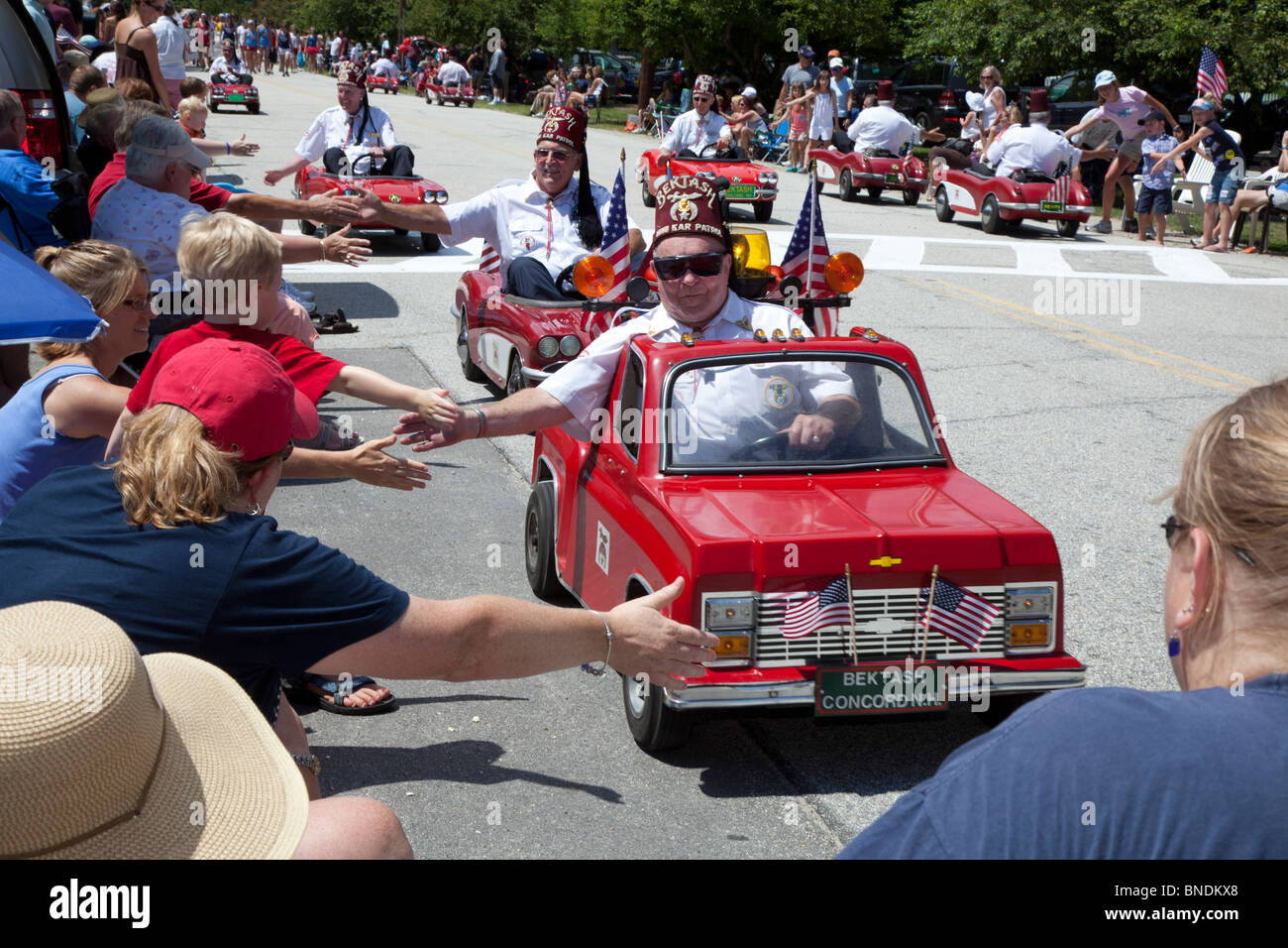 Shriners drive small cars in july 4 parade