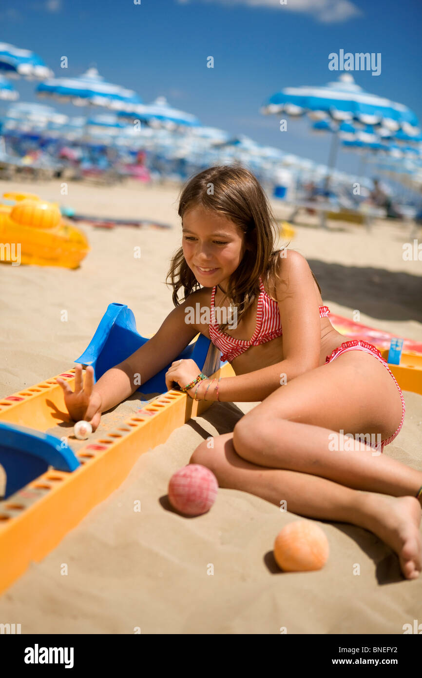 8/10 years old girl playing at the beach Stock Photo: 30437990 - Alamy