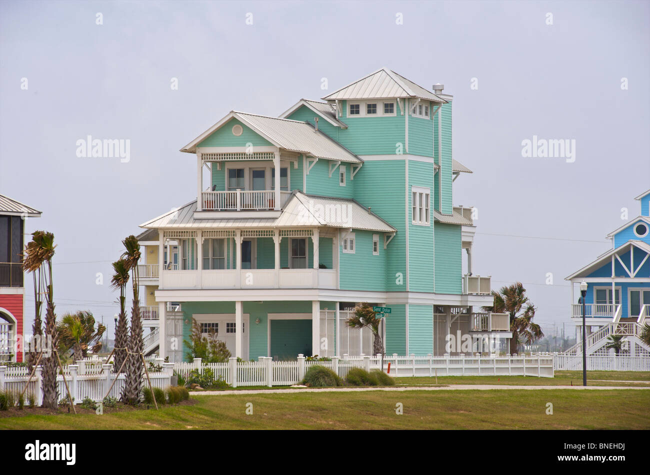 Sea green colored wooden house s architecture galveston for Beach house plans galveston