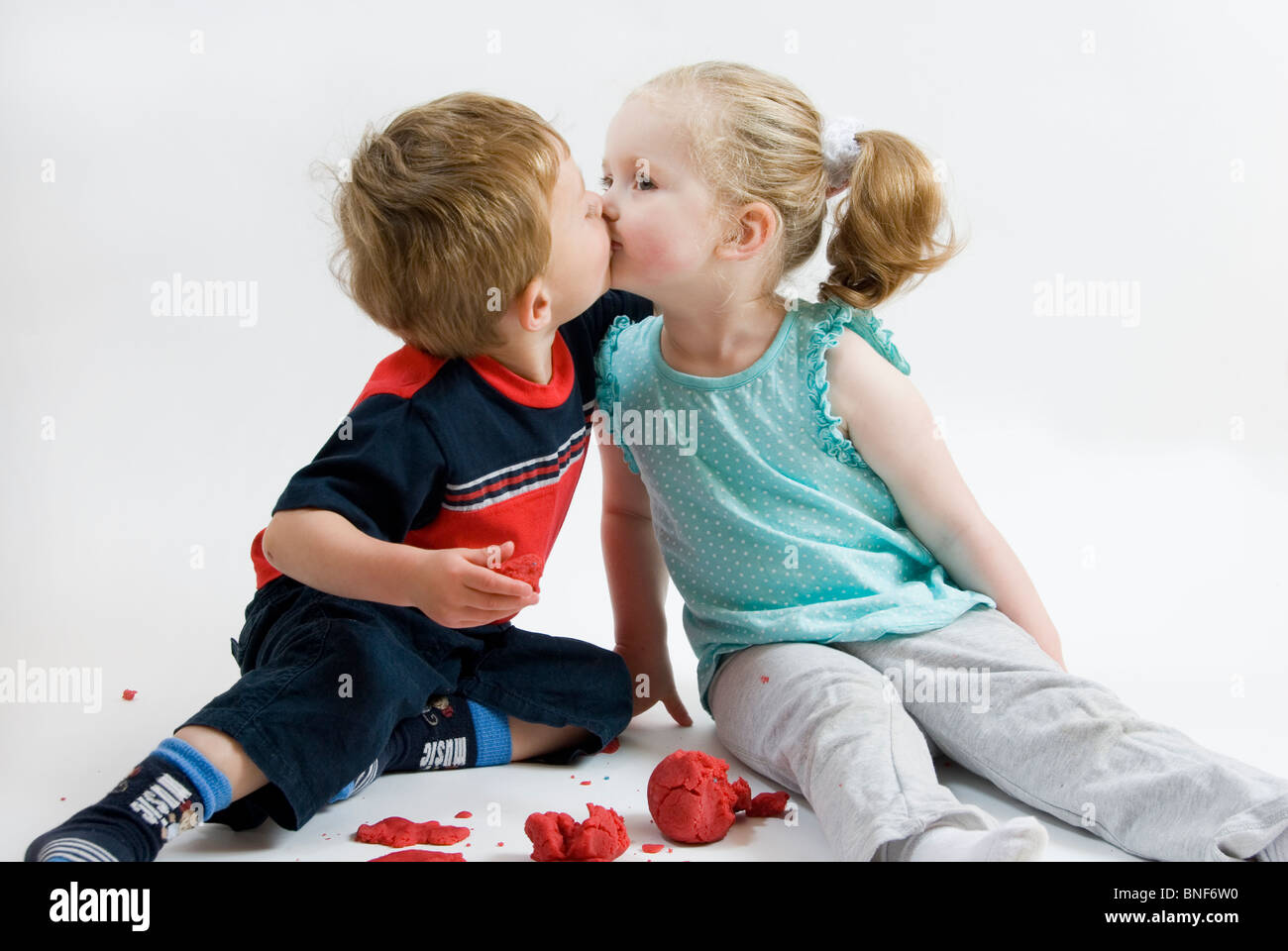 Portrait of Two Toddlers Boy and Girl Kissing, First Love ...