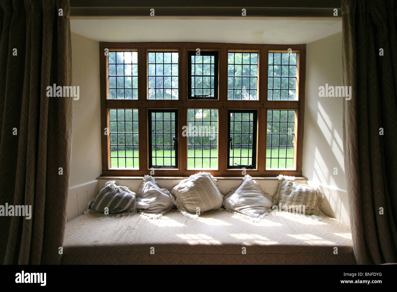 Window seat in an elizabethan country house england uk Window seat house