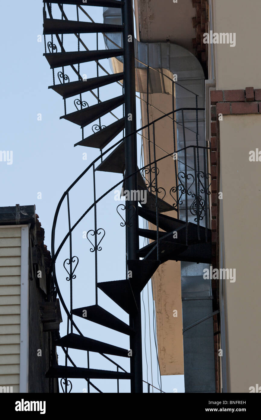 A Wrought Iron Spiral Staircase Fire Escape On The Outside Of A Building In  Istanbul