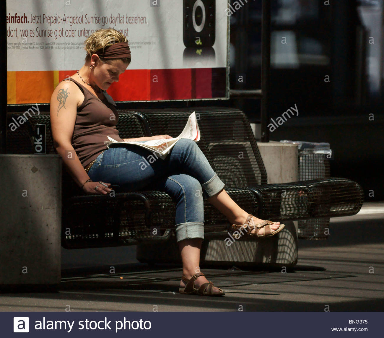 Tattoo Woman Reading: Young WOMAN With Tattoo On Arm Reading Newspaper Sitting