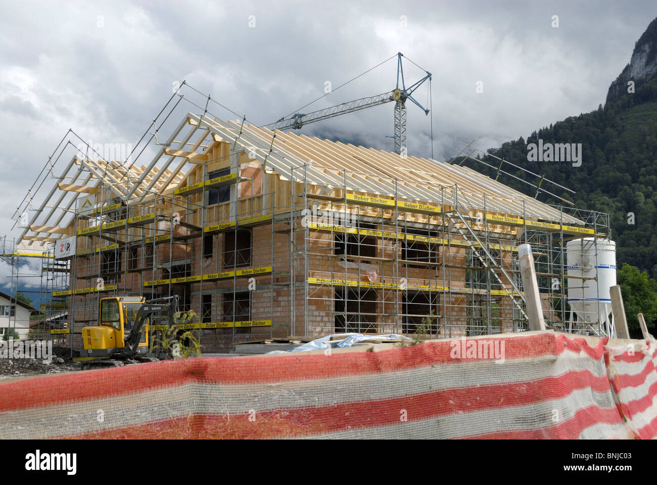 house home building site new building build crane land country house home building site new building build crane land country rurally roof shell position situation wood