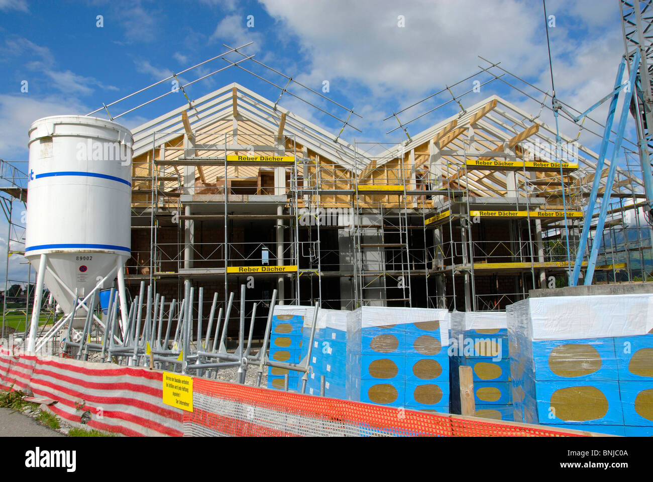 house home building site new building build crane roof shell house home building site new building build crane roof shell position situation wood forest apartment house