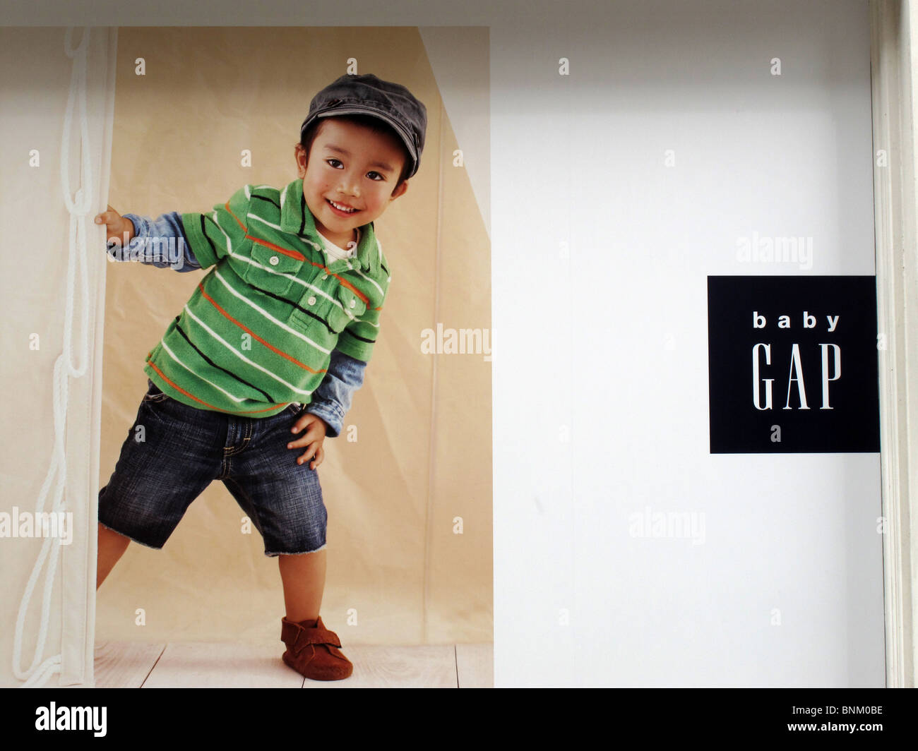 Baby Gap Advert child cute poster logo clothes Stock Photo ...