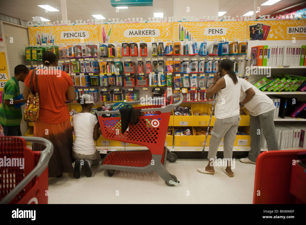 shoppers at the back to school supplies in the new target store in stock photo royalty free. Black Bedroom Furniture Sets. Home Design Ideas