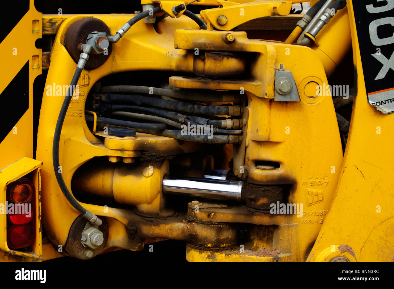 close up of a jcb digger found on a construction site stock photo