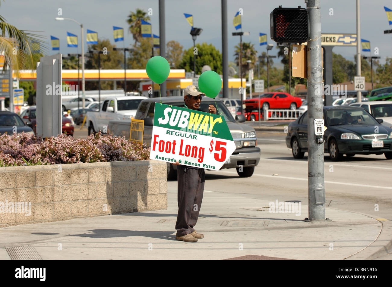 Human Billboard- A man holds an advertising sign on the ...