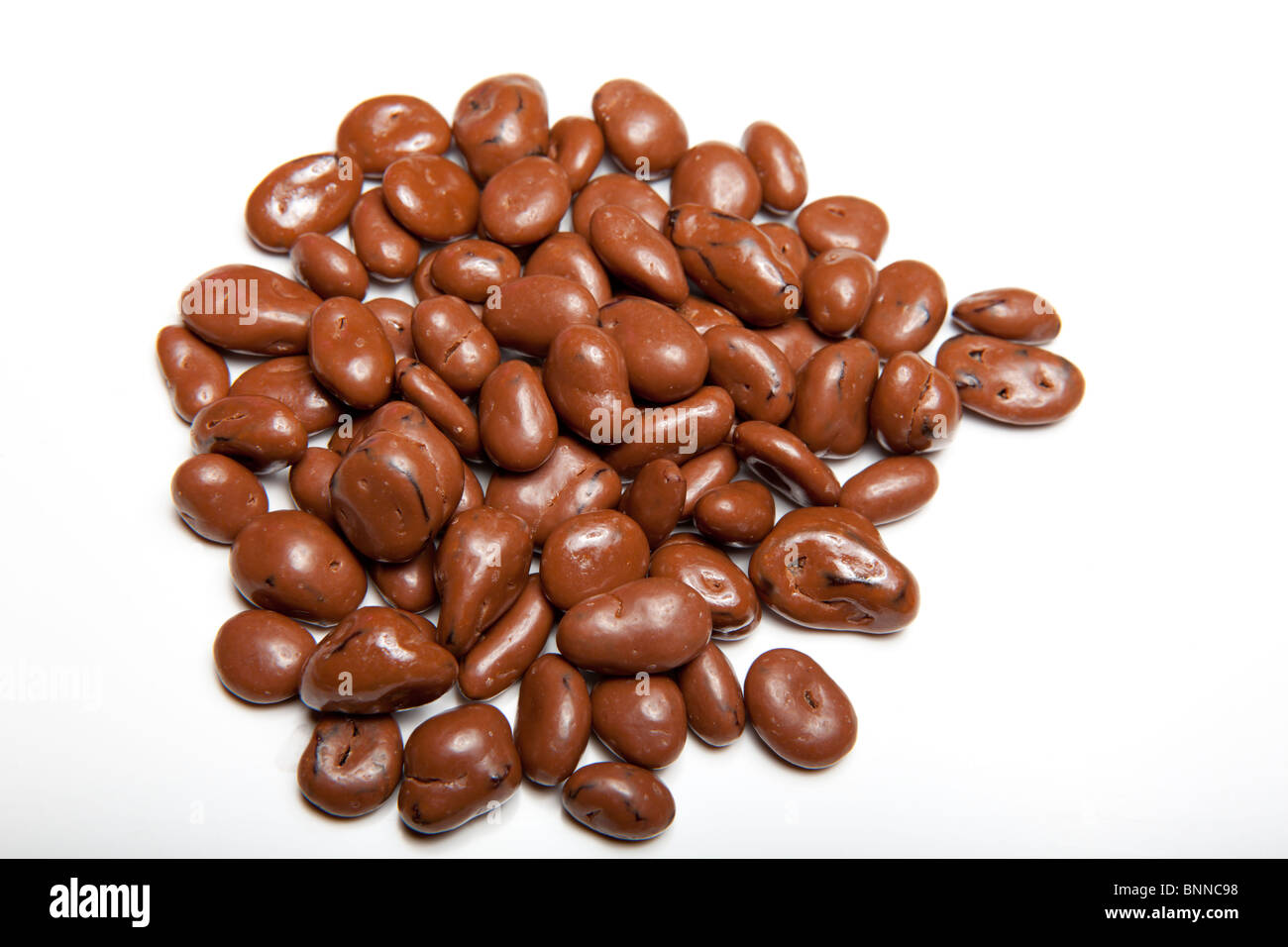Chocolate covered raisins on a white background Stock Photo ...