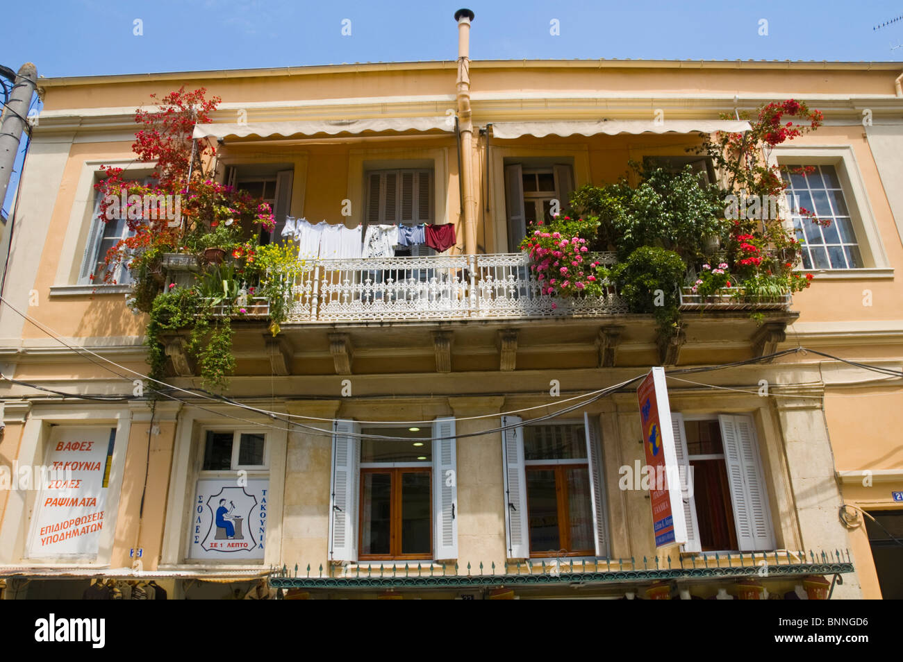 Traditional style apartment building with balcony plants in old ...