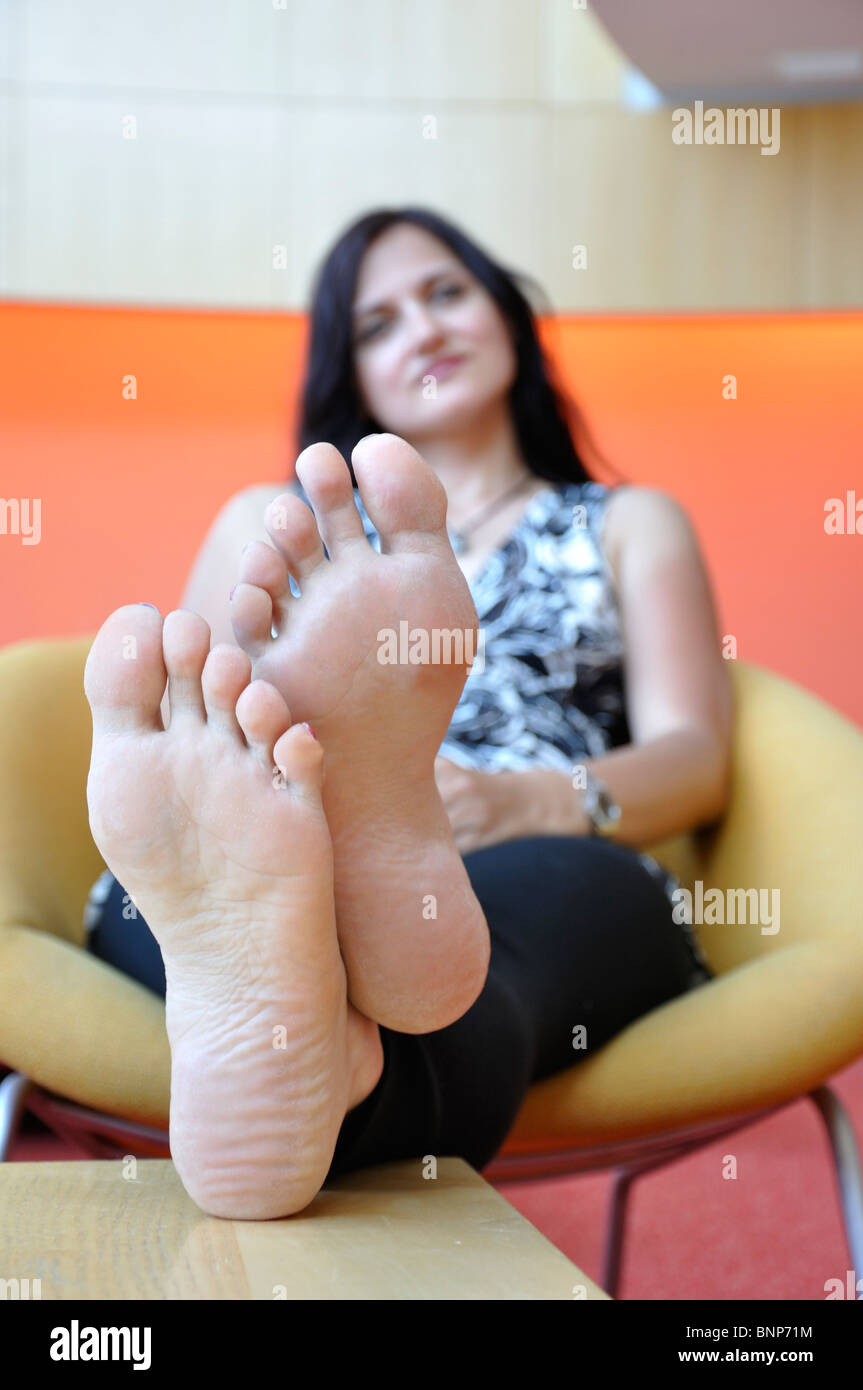 Girl Sitting With Her Feet Up Stock Photo Royalty Free Image 30606624 Alamy