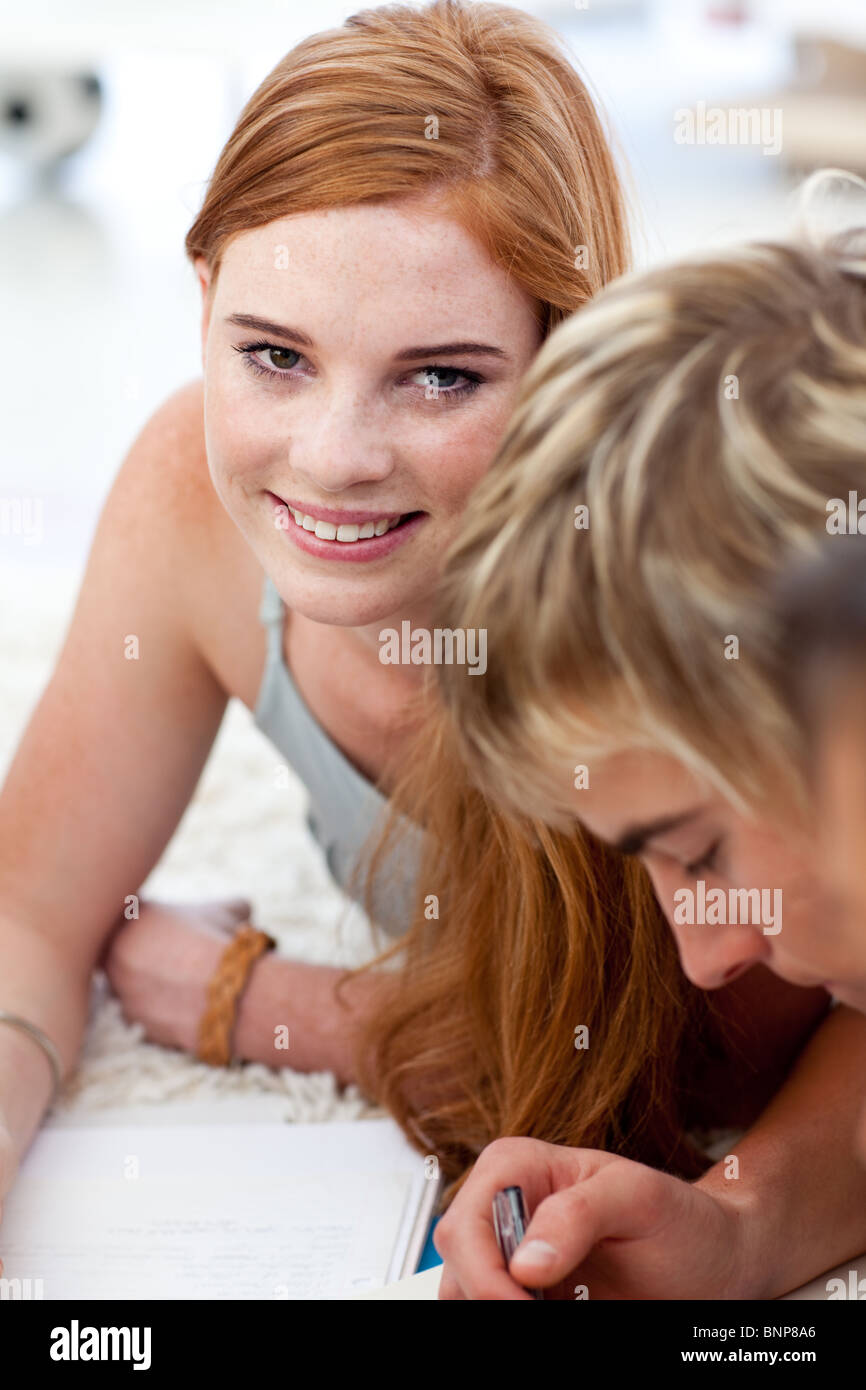 Portrait of a teen guy doing homework Stock Photo, Royalty Free ...