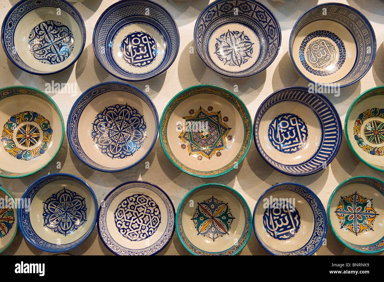 Moroccan ceramics stock photos moroccan ceramics stock images a group of ceramic bowls on a wall at a ceramics factory in fes morocco reviewsmspy