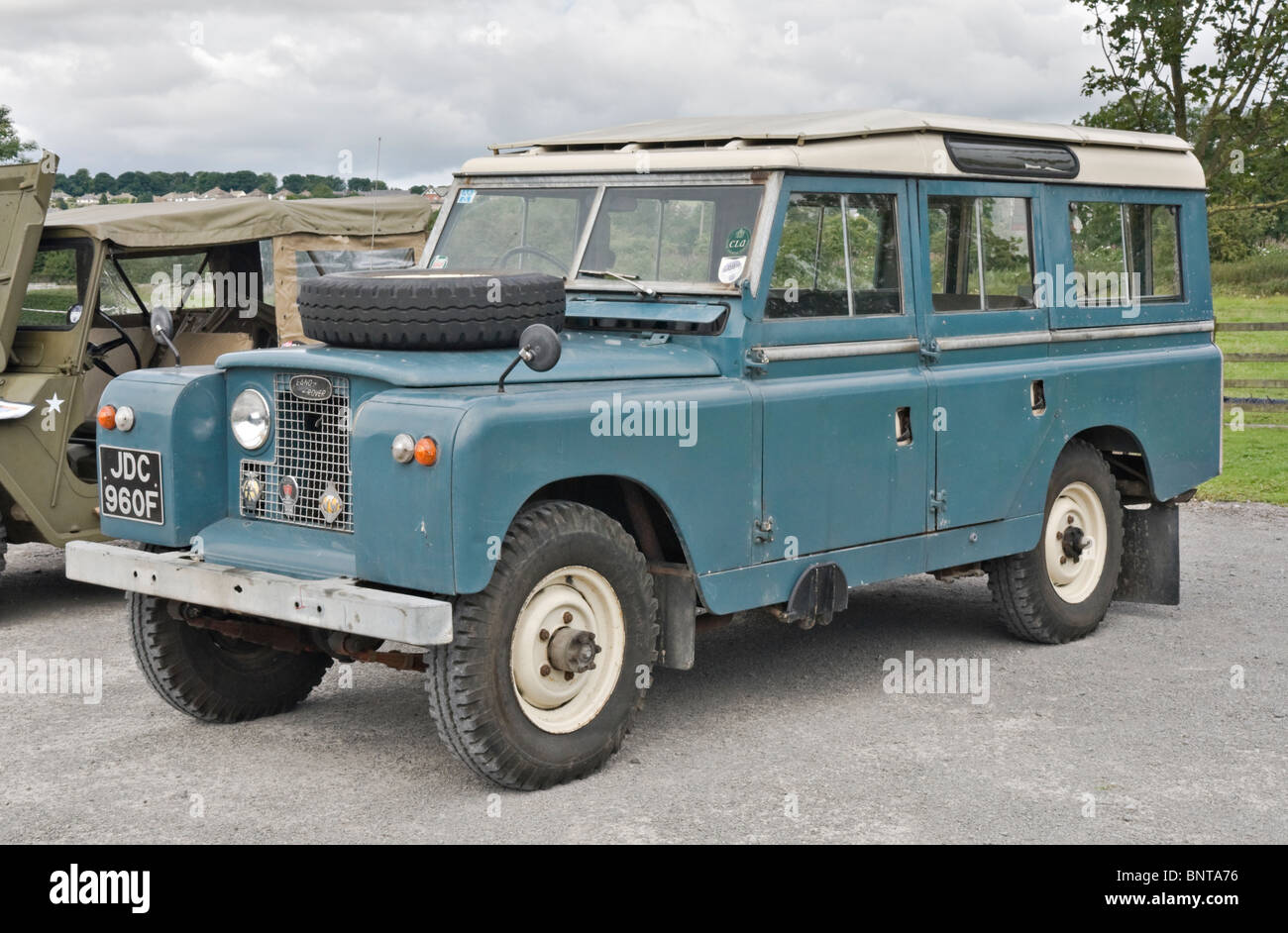 Land rover series ii long wheel base parked next to an old jeep at a rally in yorkshire