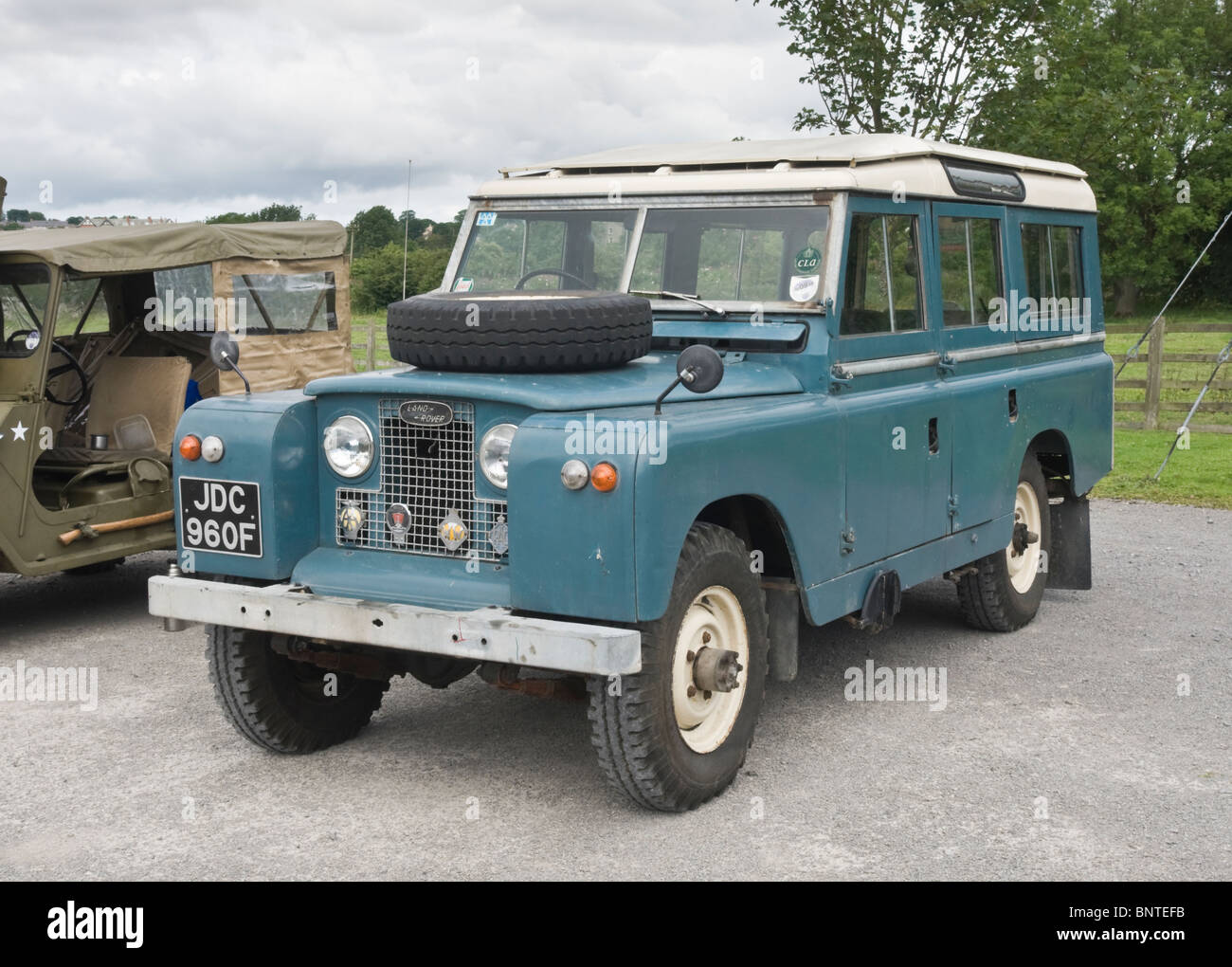 Land Rover Series Ii Long Wheel Base Parked Next To An