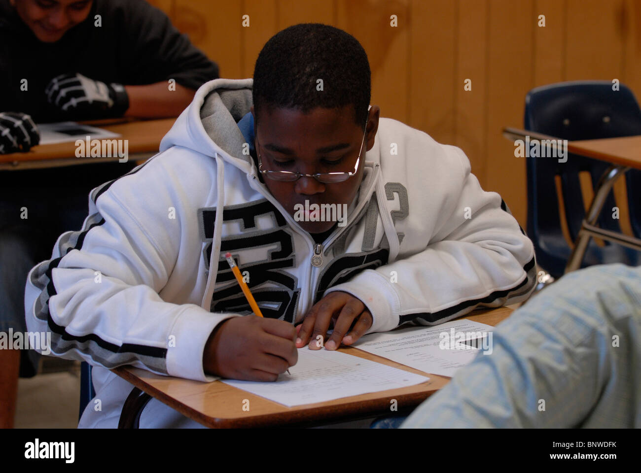 african american boy in th grade english class works on writing african american boy in 9th grade english class works on writing skills while developing