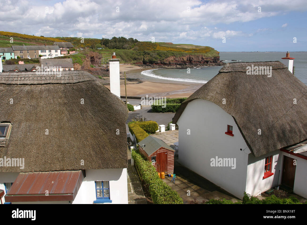 Ireland, Waterford, Dunmore East, Beach And Thatched Cottages