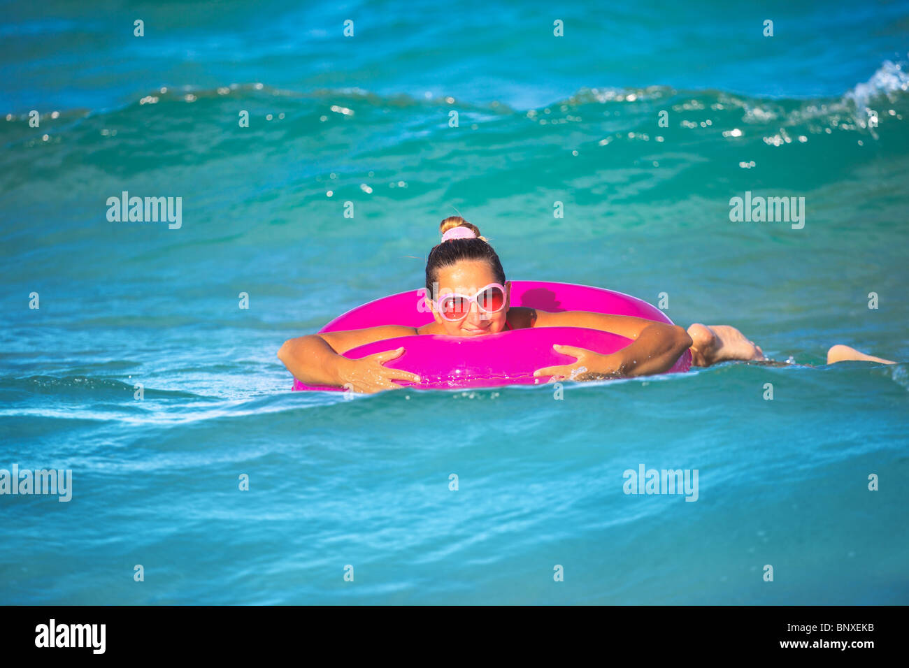Woman With Inner Tube On The Tropical Beach