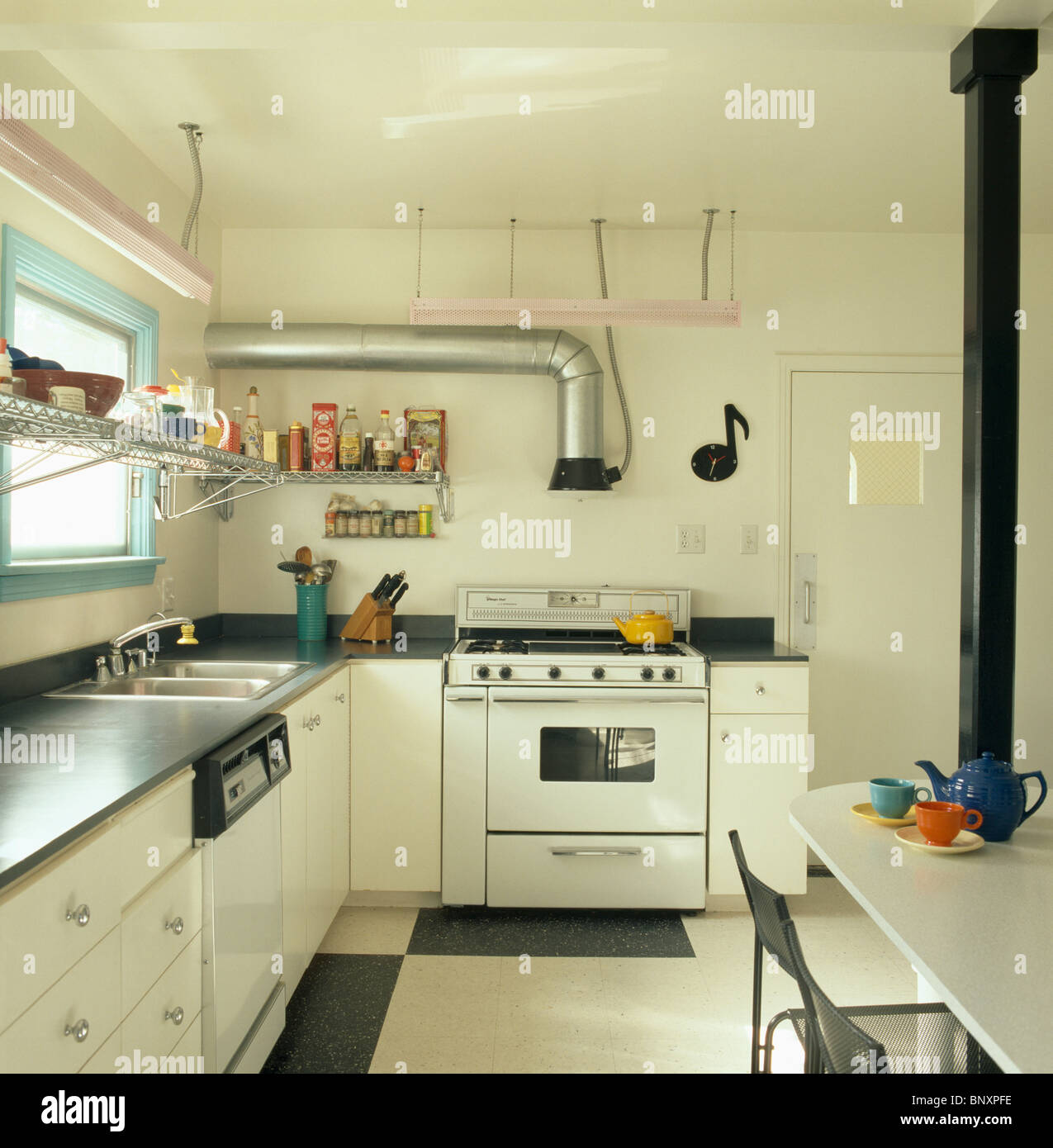 stainless steel extractor pipe and white range oven in. Black Bedroom Furniture Sets. Home Design Ideas