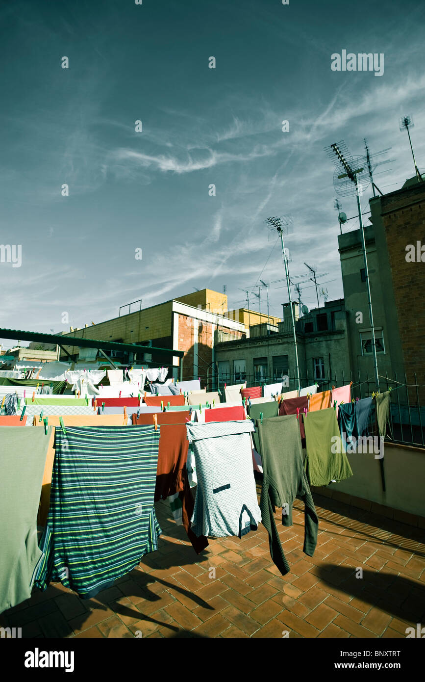 Laundry Drying On Rooftop Clothes Line Stock Photo