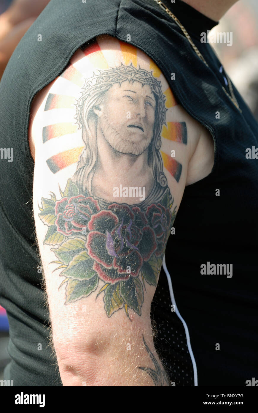 Side view of a tattoo of jesus christ on a man 39 s right arm for Jesus tattoos on arm