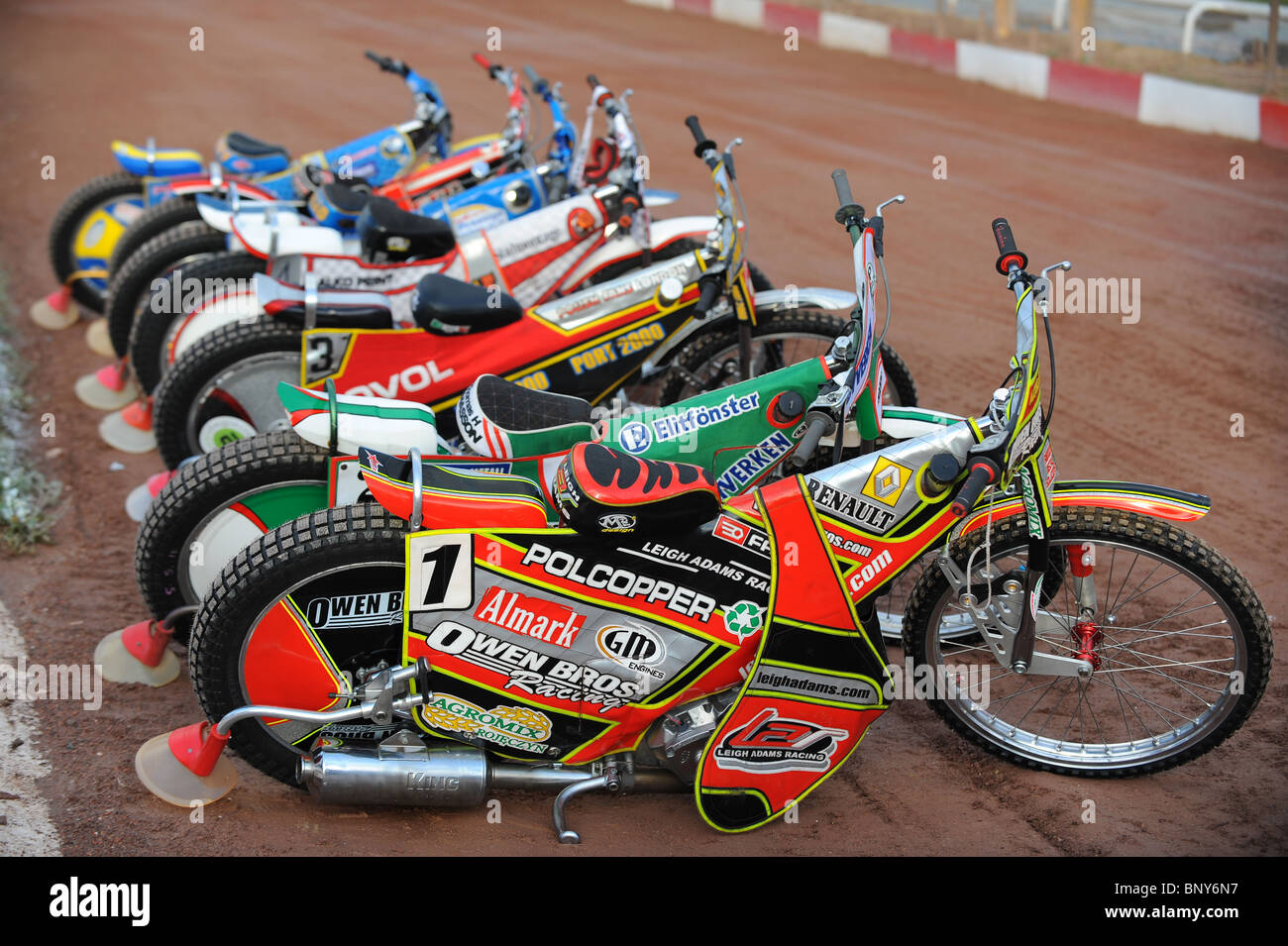 Speedway Motorcycle Racing Bikes: Speedway Bikes Are Lined Up On The Track Before Racing