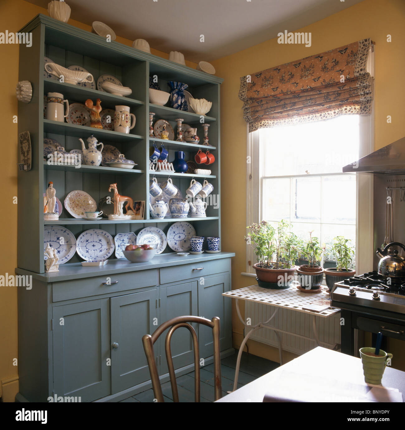 Blue green dresser with crockery on shelves in traditional for Traditional kitchen shelves