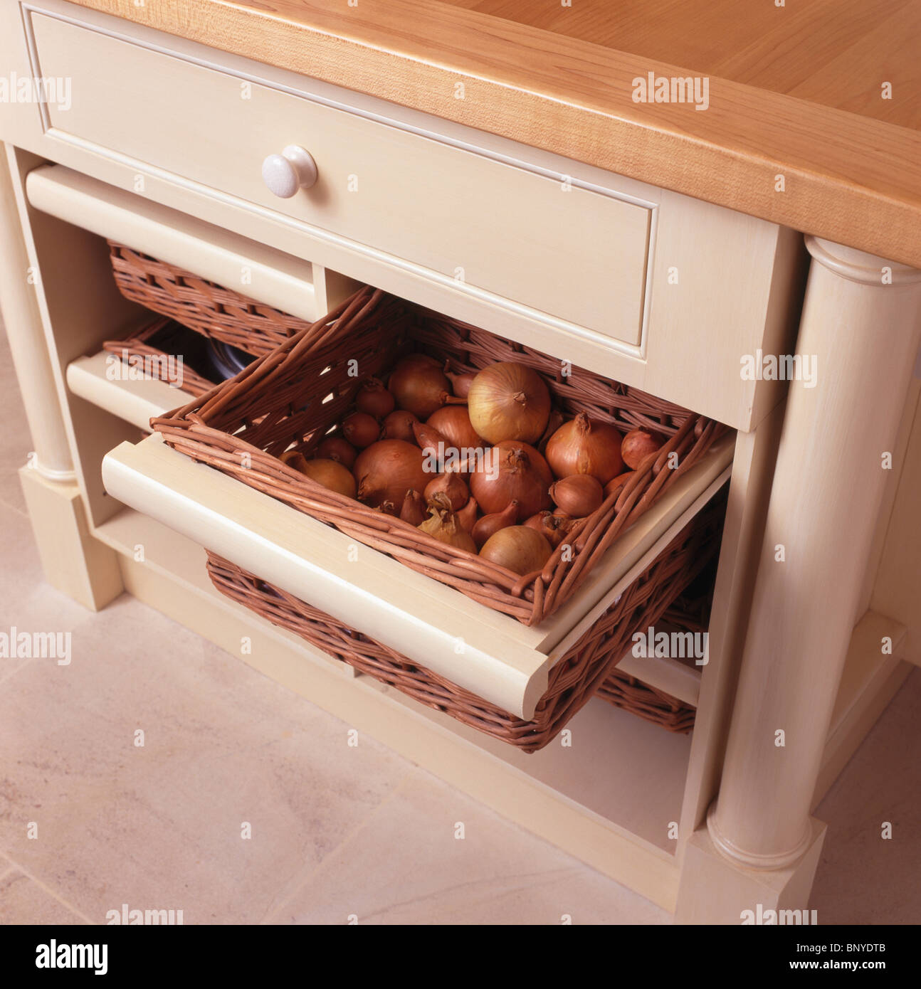 Kitchen Storage Unit Closeup Of Onions Stored In Basket In Fitted Kitchen Storage Unit