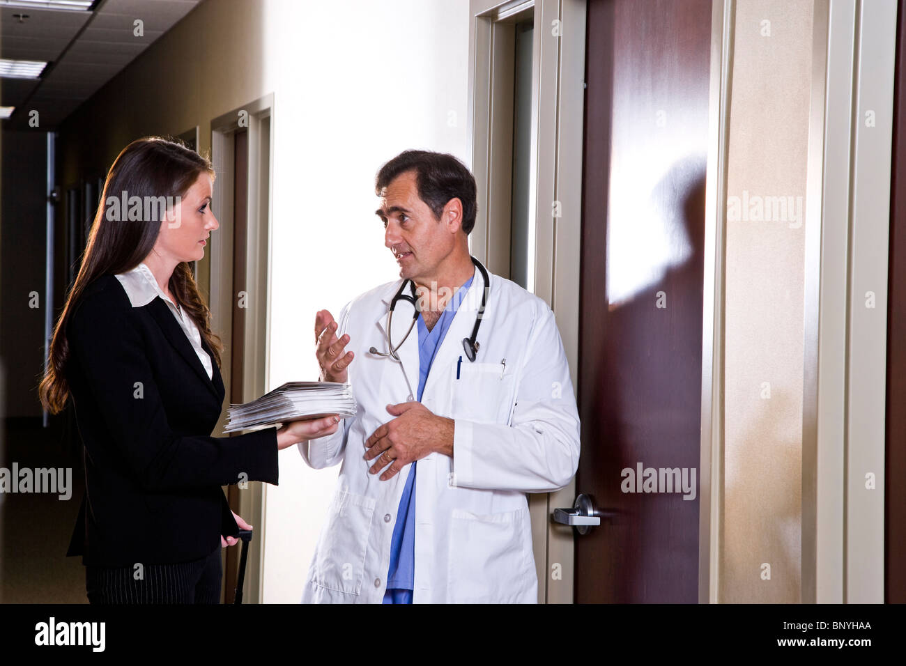 pharmaceutical rep stock photos pharmaceutical rep stock images doctor talking pharmaceutical s rep in office corridor stock image