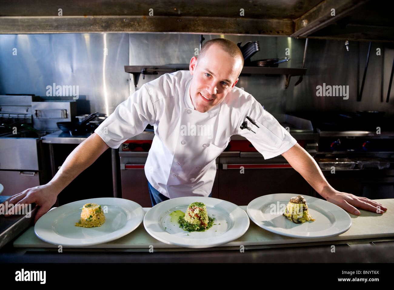 Restaurant Kitchen Chefs chef in restaurant kitchen preparing gourmet dishes stock photo