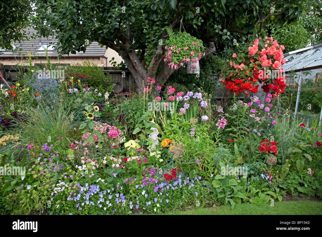 Colourful display of flowers in garden of small bungalow - Small backyard flower gardens ...