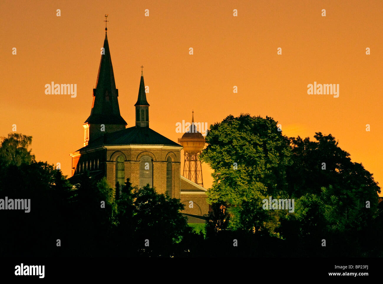 Church__water_tower_at_night_set_against