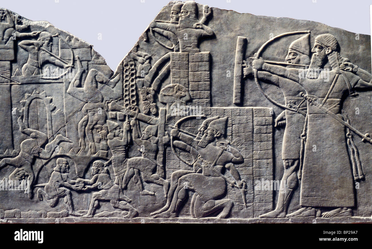ASSYRIAN ARMY ATTACKING A FORTIFIED CITY. NOTE THE ...
