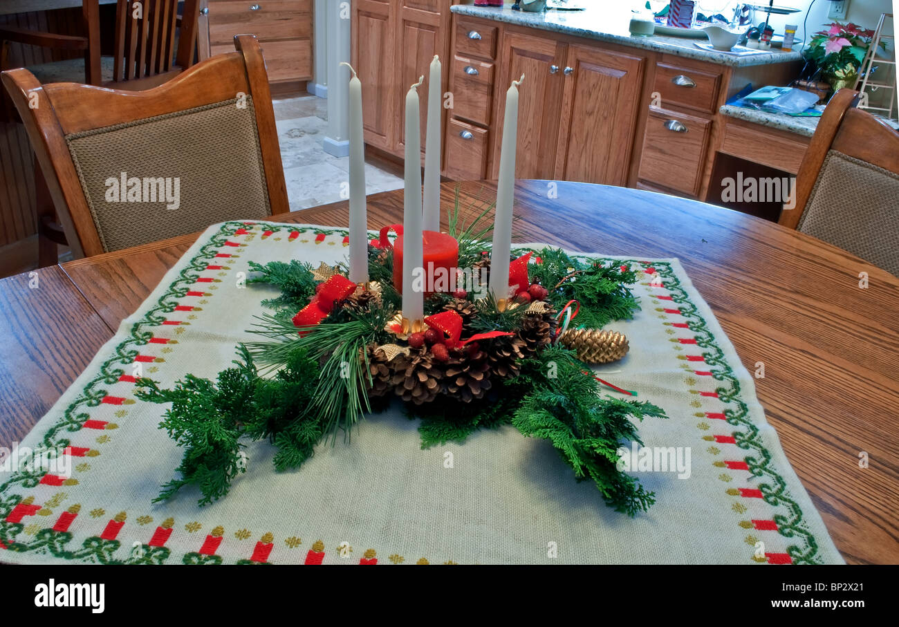 Christmas table centerpiece with evergreen boughs