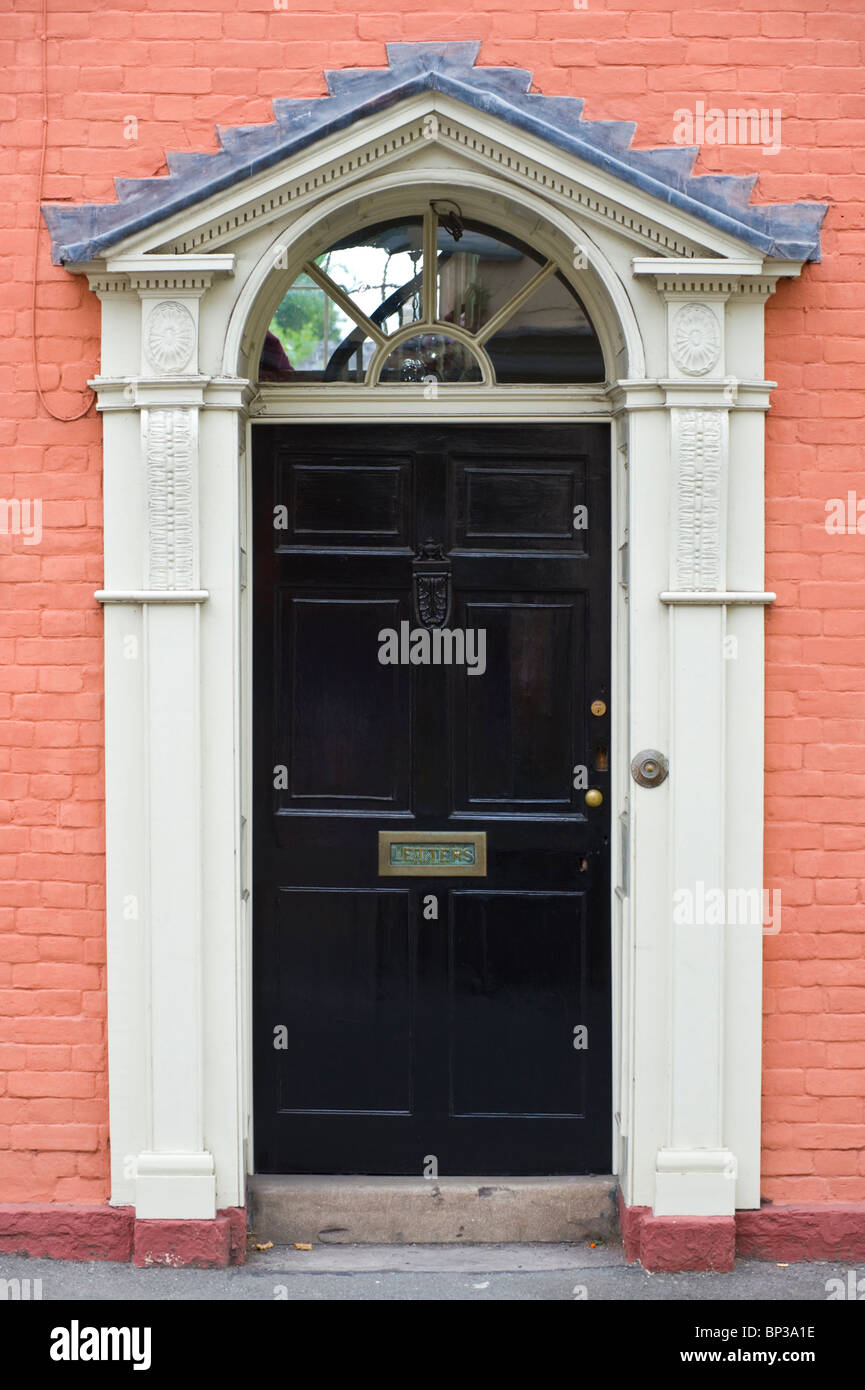 Black wooden front door with brass letterbox knocker and for Black wooden front door
