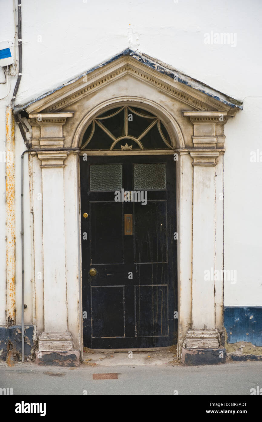 Scruffy black wooden paneled front door no 16 with white for Black wooden front door